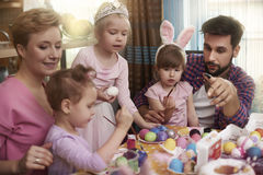 Family painting Easter eggs Stock Images