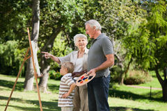 Family painting in the garden Stock Photos