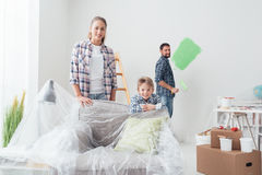 Family painting their home royalty free stock images
