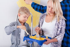Family painting wall Stock Photography