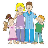 Family in Pajamas. A family of four is dressed in their pajamas. There is a boy and a girl, a Mom and a Dad Royalty Free Stock Photography