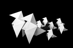 Family of paper birds on black background Stock Photos