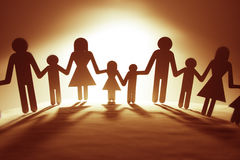 Family. Paper chain cutout holding hands Stock Images