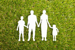 Family Papercut On Grass Royalty Free Stock Photo
