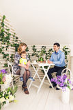 Family, parenthood, happy birthday and holiday concept - happy parents and child at a table drinking tea and eating cake.  royalty free stock photos