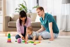 Happy family with baby boy playing at home royalty free stock photos