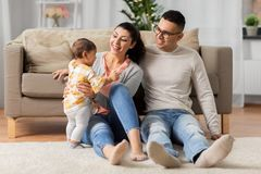 Happy family with baby daughter at home royalty free stock photography