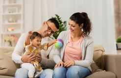 Happy family with baby daughter at home. Family, parenthood and people concept - happy mother, father with baby daughter at home Royalty Free Stock Photo