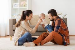 Happy family with baby having fun at home Royalty Free Stock Images