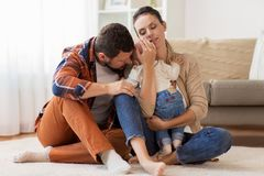 Happy family with baby at home Stock Photos