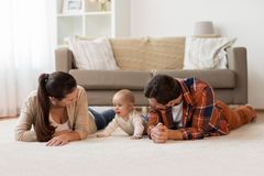 Happy family playing with baby at home Stock Photography