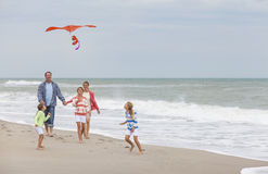 Family Parents Girl Children Flying Kite on Beach Stock Photos