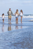 Family Parents Girl Children Walking on Beach Stock Photo