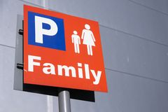 Family parents with kids children car park sign at shopping mall retail park. Uk royalty free stock images
