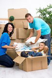 Family, parents, son, unpacking boxes and moving into a new home Stock Photo