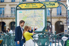 Family in Paris, looking at subway map Royalty Free Stock Photo