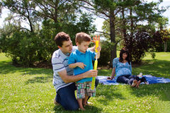 Family in park. Family playing together in park Stock Photography