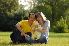 Family in park. Father, mother and child in park Stock Photos