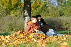 Family in park on autumn Stock Photos