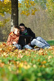 Family in park on autumn Stock Photo