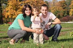 Family in the park in autumn 2 Stock Photo