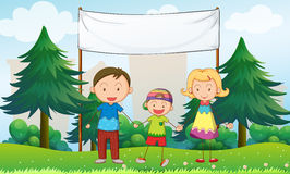 A family at the park with an empty banner Stock Photography