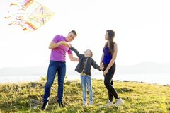 Family in a park. A happy family spending time outside together royalty free stock photos