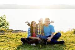 Family in a park. A happy family spending time outside together royalty free stock photography