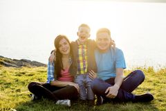 Family in a park. A happy family spending time outside together royalty free stock images