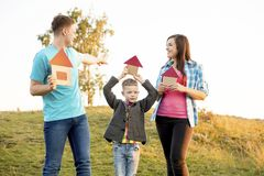 Family in a park. A happy family spending time outside together stock photography