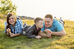 Family in a park. A happy family spending time outside together stock images