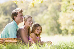 Family at park having a picnic and smiling Royalty Free Stock Image