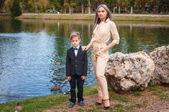 Family in the Park by the lake, mother and son.  stock photos