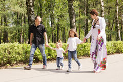 Family on a park road Royalty Free Stock Photography
