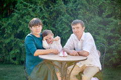 Family in the park at the table.  Royalty Free Stock Photos