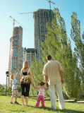 Family in the park watching the construction Stock Images