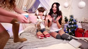 Family party on Christmas Eve, cheerful family holiday in a warm cozy atmosphere, Mom and daughters drink tea in New stock video