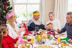 Family in party hat having fun at christmas time Stock Images
