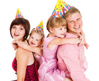 Family in party hats Stock Images