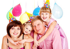 Family in party hats Stock Photo
