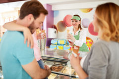 Family in pastry shop buying ice cream Stock Photo
