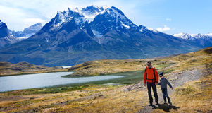 Family in patagonia. Family of two, father and son, enjoying hiking and active travel in torres del paine national park in patagonia, chile, view of cuernos del stock image