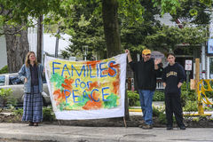Family for Peace. Family supports peace with a colorful sign Stock Photos