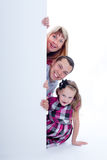 Family peek out surprised and smiling Royalty Free Stock Photography