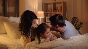 Happy family having fun in bed at home stock video