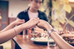 Family people praying before Thanksgiving dinner at home.  stock photo