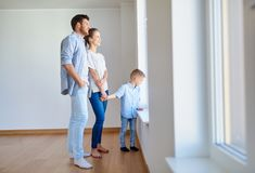 Happy family with child at new home or apartment Stock Image