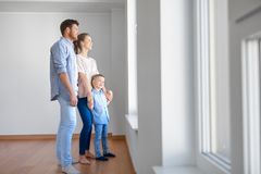 Happy family with child at new home or apartment Stock Photography