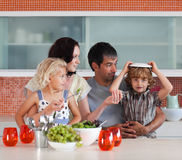 Free Family Perparing Lunch In The Kitchen Royalty Free Stock Images - 9137869