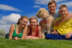 Family with pet. Parents with their children and dog Royalty Free Stock Photos